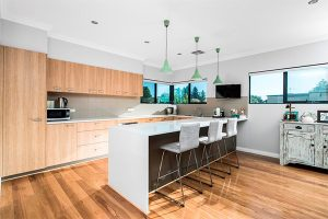kitchen renovation using timber flooring and cabinets