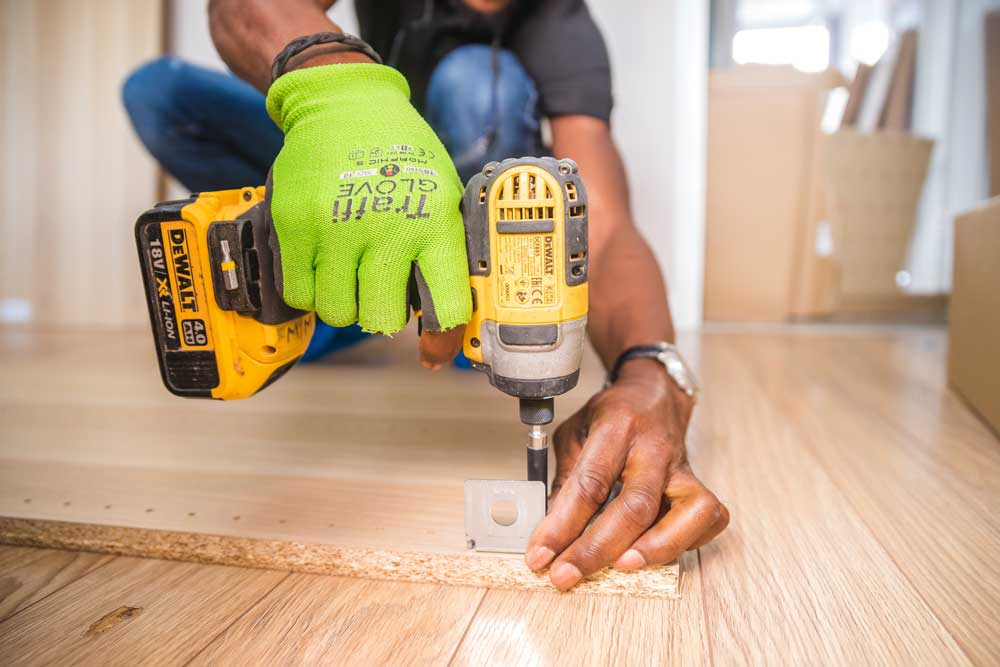 Tradie working with a drill